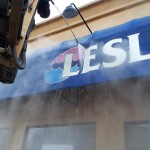 sign being washed by power washer