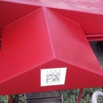 freshly power washed red awning